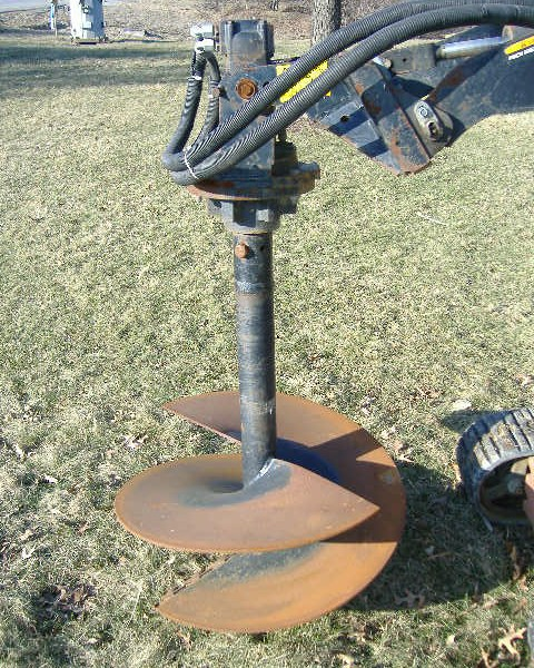 Skidloader w/ Auger Attachment