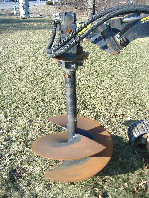 Skidloader with Auger Attachment