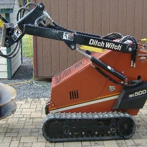 Mini Skidloader w/ Auger Attachment