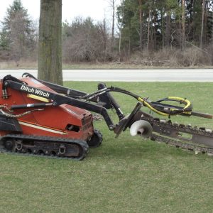 Mini Skidloader with Trencher Attachment